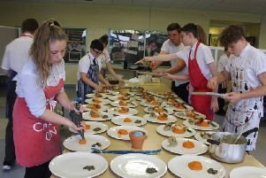 Students help prepare the feast.