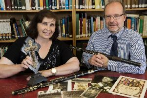 Sharon Lynas, grand-daughter of Corporal Albert James Kendall, with Mike King, Down County Museum heritage manager and her grandfather's artefacts