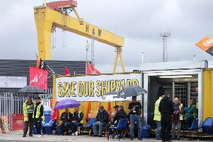 Workers making their point at the gates of the famous shipyard, which went into administration last week