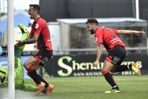 Chris Hegarty (right) celebrates scoring on his Crusaders debut. Pic by INPHO.