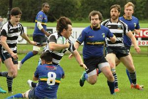 Ballymoney winger, Nathanial Steele, is brought to ground by the  resolute Lisburn defence. Photo: Uel McDowell