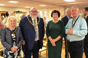 Guild Care chief executive Suzanne Millard and chairman Allan Reid, right, at last year's annual meeting with the then Worthing mayor and mayoress Paul and Sandra Baker