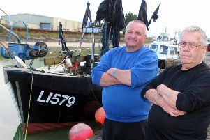 DM19101770a.jpg. Fishermen angry by change to fishing laws which means they cannot fish near the shore. Sean Hunter, left and his dad Bill. Photo by Derek Martin Photography.
