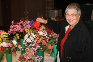 Val O'Neill won the Red Ribbon for best exhibit of flowers from the garden at last year's autumn show. Picture: Derek Martin DM18103753a