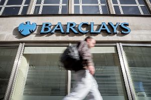 A pedestrian walks past a branch of Barclays bank in central London on October 22, 2017. / AFP PHOTO / AFP PHOTO AND Tolga Akmen / Tolga Akmen        (Photo credit should read TOLGA AKMEN/AFP/Getty Images) NNL-191022-122331001
