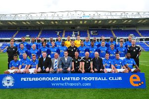 Lord Mawhinney pictured with the Peterborough United squad in a team picture ahead of the  2012-13 season.