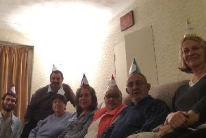 Baha'is and friends in their party hats