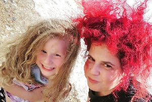 Candy Medusa, right, is raising awareness of plastic pollution
