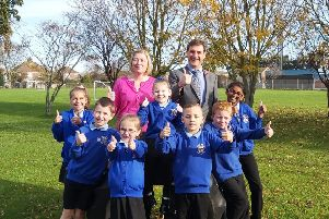 Dave Ayers, head of school at River Beach Primary School in York Road, Littlehampton, with Rhona Wilkinson, deputy headteacher celebrating Ofsted success with pupils