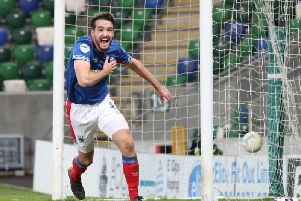 Josh Robinson celebrates his late winner against Larne