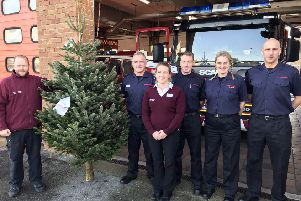 Shoreham firemen receiving their Christmas tree from Mayberry Garden Centre
