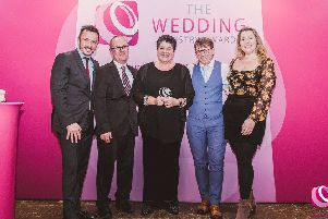 Amanda Millis, weddings and functions manager, with the team from Field Place Manor House & Barns accepting the award for best town or city wedding venue in the south east