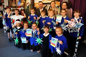 Steyning Primary School pupils deliver Christmas decorations and Christmas cards to Igor Srzic-Cartledge at Dandylion Style for his community Christmas Day party. Picture: Steve Robards SR18121902