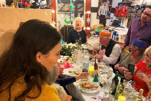 Dandylion Style owner Igor Srzic-Cartledge, right, with his guests in the shop in Christmas Day