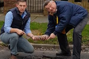Martin McCabe and Bob Smytherman 'celebrated' with a cake and candles by the hole on Palatine Road
