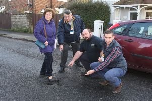 DM2010157a.jpg. Potholes in Tarring Road, Worthing. From left, Cllr Hazel Thorpe, Cllr Bob Smytherman, resident Colin Wigham and Cllr Martin McCabe. Photo by Derek Martin Photography SUS-200701-134907008