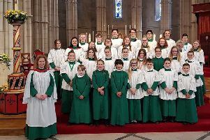 Elizabeth Stratford, organist and master of the choristers, with the Arundel Cathedral choir. Picture: Christopher Gaskell
