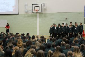 Mandarin Excellence Programme students singing at the school assembly