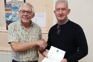 Dai Hudd, right, presents Shoreham Foodbank project manager Paul Comber with the �5,000 donation