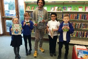 Performance poet Joseph Coelho with pupils from Steyning CE Primary School