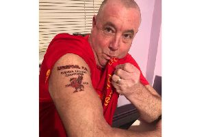 Mark Gretton, 53, with his Liverpool Premier League Champions 2019/20 tattoo