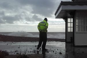 A foreshore inspector keeping an eye on things on Worthing seafront at high tide this morning