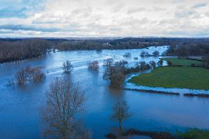 Floodwater at the site near Henfield which campaigners say is earmarked for development of 7,000 new homes by Mayfield Market Towns. Photo: RWCS