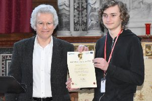 Aaron Poulter receives his certificate from Peter Millican, professor of philosophy at Hertford College, Oxford