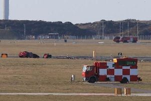 Wreckage after a Red Arrow jet crashed at RAF Valley in north Wales (Peter Byrne/PA)