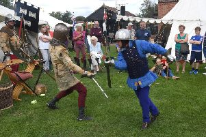 Dave Bedford (left) and James Thomes different demonstrating swords at the Village Church Farm.