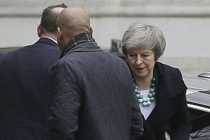 Theresa May arrives at 10 Downing Street today