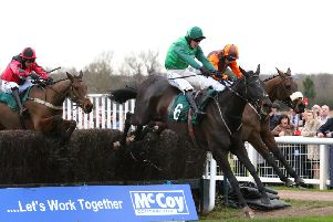 Calett Mad leads Impulsive Star over the final fence in the McCoy Contractors Civil Engineering Classic Handicap. Picture: www.dwprattracingphotography.co.uk