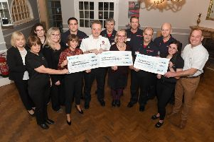 Staff at the Crown Hotel, Skegness, present a  cheques to Firefighters Charity.Pictured (left to right) are Cheryl Herring, Paula Miles, Dempsey Briggs, Michelle Mosley, Abby Rawlings, Johny Lintin, Kevin Beard, Tony Edwards, Gail May, Mike Shaw, Carl Rawlings, Paul Smith, Tori Bryan, Wayne Topley. (Firefighters were from Wainfleet. Gail May and Wayne Topley were presenting a cheque on behalf of Sue&Geoff Hill) ANL-190128-121327001