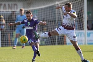 Hastings United captain Sam Adams tussles for possession during Saturday's 1-1 draw at home to Guernsey. Picture courtesy Scott White