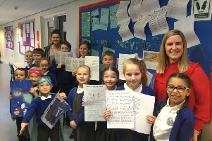 pupils of Friskney All Saints (C of E) Primary School launch their campaign agaignst the use of pleastic. Miss Lauren Goodwin (Year 3/ 4 teacher) is pictured leftand Miss Emma Taylor (Head Teacher) ,  right. ANL-190402-103045001
