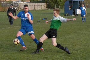 Swineshead (blue) v Pointon (green). George Bakes (blue), Sean Mason (green)