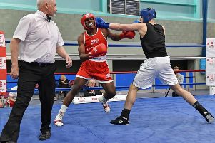 Rugby's Ben Gidley (in the black vest) on his way to a semi-final victory over Tino Bellot from the Dale Youth boxing club in London