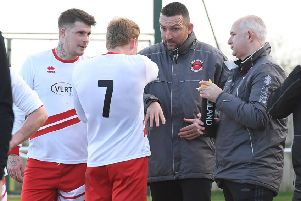 Nathan Collins and Nick Chapman, right, in discussion with the team on Saturday.