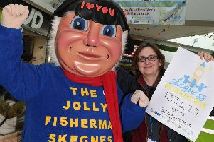 Skegness Mayor unveils a Volometer at Hildreds. Kathryn Laverack of Lincolnshire CVS with Jolly Fisherman. ANL-190325-121415001
