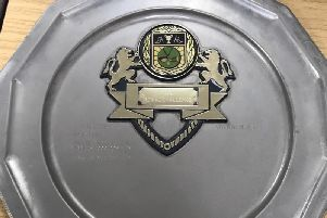 Police have released a photo of a silver plaque found in Aylesbury yesterday (Thursday) as they bid to reunite it with its owner