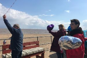 Family and friends of Dolly Williams gathered on the promenade in Ingoldmells by the Beach Ability storage unit for the dedication of a bench in her memory.