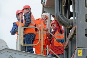 Coalisland man Justin Donnelly recently celebrated an impressive 50 years' service with Terex pictured in the white hat