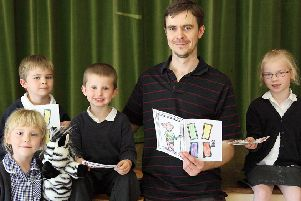 Pictured with author David Bedford, from left, Niamh Dunn, Brandon Whitlock, five, Tomi Smith, five, and Olivia Alcock.