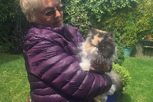 Jean Hart with Aurora, who was rescued when Brewster Lane in Wainfleet was flooded.