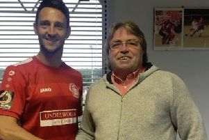 Tudors' new signing Luke Howell with chairman Dave Boggins.