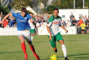 Jimmy Muitt puts the Pompey defence under pressure / Picture by Tommy McMillan