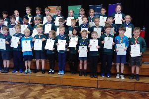 The youngsters accepting their Scouting awards
