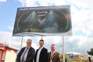 Councillor Steve Kirk, Sam Robbens and Councillor Mark Dannatt with an artist's impression of the completed work