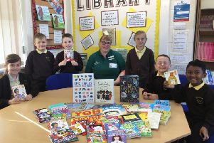 Pupils from the Richmond School, Skegness with books donated by Tesco.