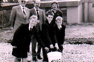Staff and students place a time capsule in the ground during construction work at St George's School 25 years ago, back in 1993. EMN-181122-145846001